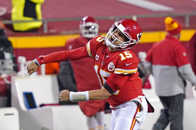 Kansas City Chiefs quarterback Patrick Mahomes celebrates after throwing a 5-yard touchdown pass to tight end Travis Kelce during the second half of the AFC championship NFL football game against the Buffalo Bills, Sunday, Jan. 24, 2021, in Kansas City, Mo. (AP Photo/Jeff Roberson)