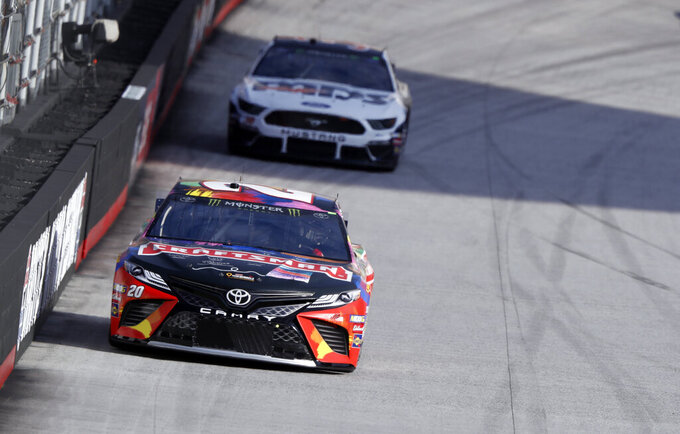 Driver Erik Jones (20) leads David Ragan (38) during practice for a NASCAR Cup Series auto race, Saturday, April 6, 2019, in Bristol, Tenn. (AP Photo/Wade Payne)