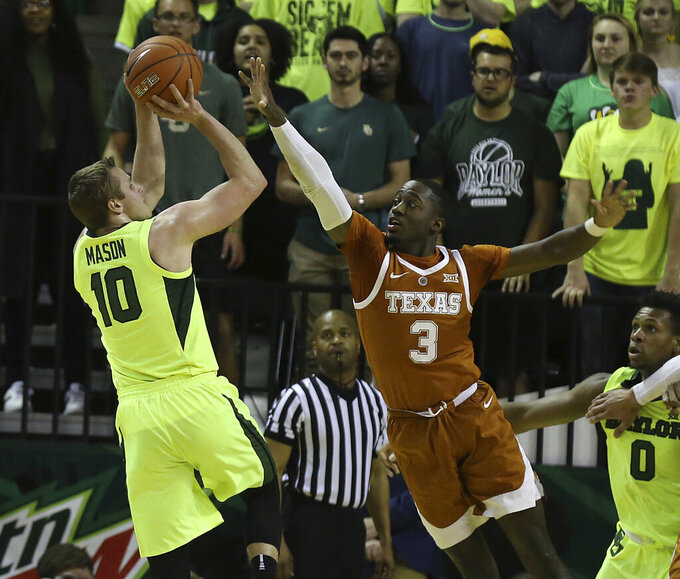 Baylor guard Makai Mason (10) shoots as Texas guard Courtney Ramey defends during the first half of a NCAA college basketball game Wednesday, Feb. 27, 2019, in Waco, Texas. (Jerry Larson/Waco Tribune Herald via AP)