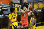 Illinois' Andre Curbelo, center, shoots between Missouri's Dru Smith, left, and Mitchell Smith, right, during the first half of an NCAA college basketball game Saturday, Dec. 12, 2020, in Columbia, Mo. (AP Photo/L.G. Patterson)