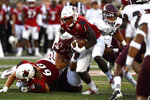 Louisville running back Hassan Hall (19) breaks through a hole in the Eastern Kentucky defensive line during the first half of an NCAA college football game in Louisville, Ky., Saturday, Sept. 7, 2019. (AP Photo/Timothy D. Easley)