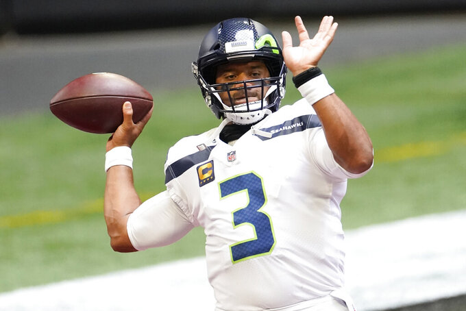 Seattle Seahawks quarterback Russell Wilson (3) warms up before the first half of an NFL football game against the Atlanta Falcons, Sunday, Sept. 13, 2020, in Atlanta. (AP Photo/John Bazemore)