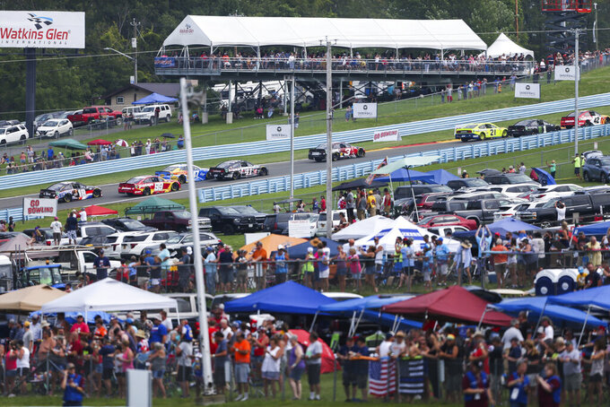 Cars drive up the esses during a NASCAR Cup Series auto race in Watkins Glen, N.Y., on Sunday, Aug. 8, 2021. (AP Photo/Joshua Bessex)