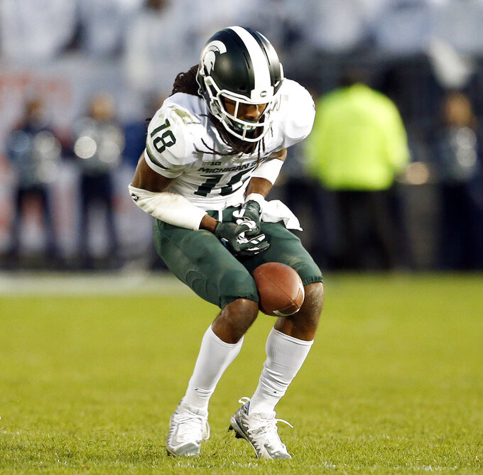 Michigan State's Felton Davis (18) catches a pass between his knees during the second half of an NCAA college football game against Penn State in State College, Pa., Saturday, Oct. 13, 2018. (AP Photo/Chris Knight)