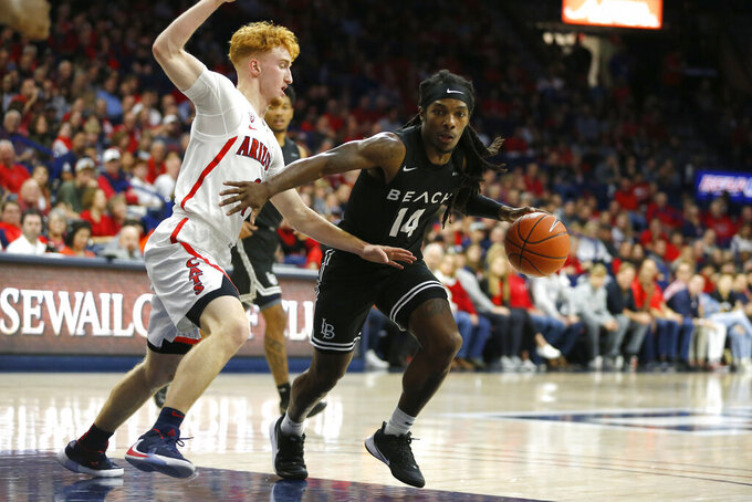 Long Beach State guard Colin Slater (14) drives on Arizona guard Nico Mannion in the first half during an NCAA college basketball game, Sunday, Nov. 24, 2019, in Tucson, Ariz. (AP Photo/Rick Scuteri)