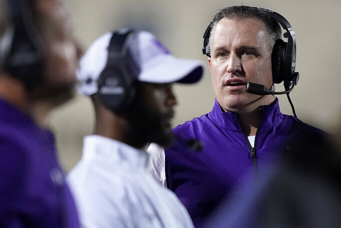 Northwestern coach Pat Fitzgerald stands along the sideline during the first half of the team's NCAA college football game against Michigan State in Evanston, Ill., Friday, Sept. 3, 2021. (AP Photo/Nam Y. Huh)