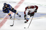 St. Louis Blues' Tyler Bozak (21) and Colorado Avalanche's J.T. Compher (37) vie for control of the puck during the third period of an NHL hockey game Monday, Oct. 21, 2019, in St. Louis. (AP Photo/Scott Kane)