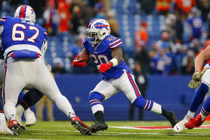 Buffalo Bills running back Frank Gore (20) runs the ball against the Denver Broncos during the fourth quarter of an NFL football game, Sunday, Nov. 24, 2019, in Orchard Park, N.Y. (AP Photo/John Munson)