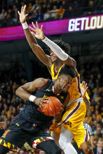 Maryland forward Bruno Fernando, front, drives against Minnesota center Daniel Oturu during an NCAA college basketball game Tuesday, Jan. 8, 2019, in Minneapolis. Maryland won 82-67. (AP Photo/Bruce Kluckhohn)
