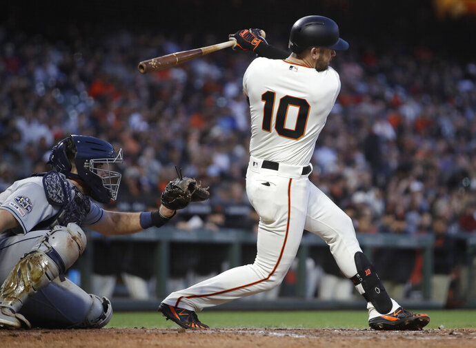 San Francisco Giants' Evan Longoria follows through on an RBI single during the fifth inning of the team's baseball game against the San Diego Padres on Wednesday, June 12, 2019, in San Francisco. (AP Photo/Ben Margot)