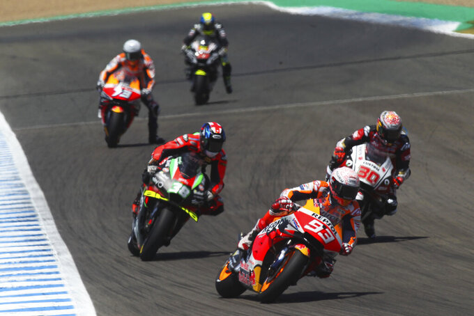 MotoGP rider Marc Marquez of Spain steers his motorcycle during the Spanish Motorcycle Grand Prix at the Angel Nieto racetrack in Jerez de la Frontera, Spain, Sunday, July 19, 2020. (AP Photo/David Clares)