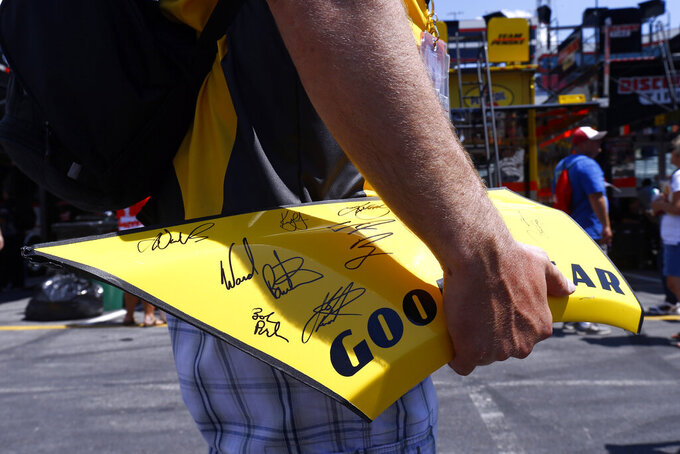 Fan Sean Remus waits to get an autograph before practice for a NASCAR Cup Series auto race, Friday, Aug. 16, 2019, in Bristol, Tenn. (AP Photo/Wade Payne)
