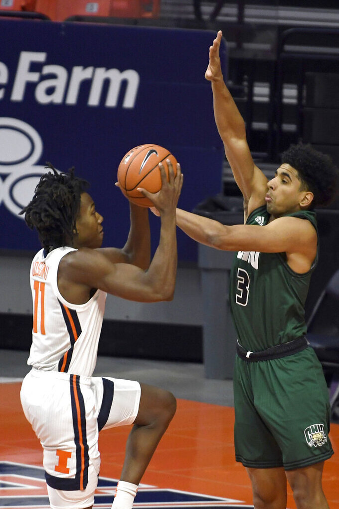 Illinois guard Ayo Dosunmu (11) puts up a shot as Ohio's Ohio's forward Ben Roderick (3) in the first half of an NCAA college basketball game Friday, Nov. 27, 2020, in Champaign, Ill. (AP Photo/Holly Hart)