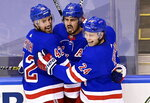 New York Rangers' Chris Kreider (20) celebrates his goal against the Carolina Hurricanes with teammates Brendan Smith (42) and Kaapo Kakko (24) during second period NHL Eastern Conference Stanley Cup playoff action in Toronto on Tuesday, Aug. 4, 2020. (Frank Gunn/The Canadian Press via AP)