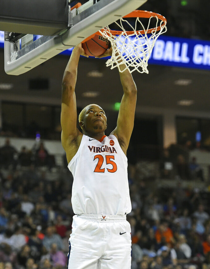 Virginia's Mamadi Diakite (25) makes a dunk against Gardner-Webb during a first-round game in the NCAA men's college basketball tournament in Columbia, S.C., Friday, March 22, 2019. (AP Photo/Richard Shiro)