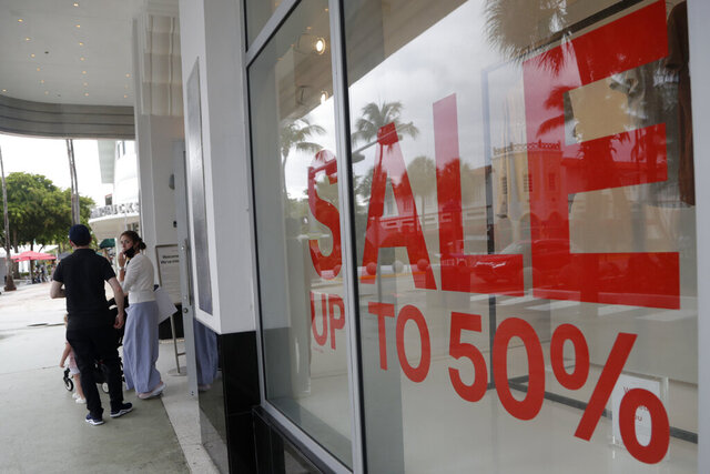 FILE - In this June 17, 2020 file photo, a sign advertises a sale at an H&M store along Lincoln Road Mall in Miami Beach, Fla.    U.S. consumer confidence had a sharp drop in July to a reading of 92.6 as coronavirus cases in many parts of the country began rising again.  (AP Photo/Lynne Sladky, File