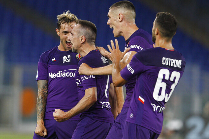 Fiorentina's Franck Ribery, seconded from left, celebrates with his teammates Fiorentina's Pol Lirola, left, Nikola Milenkovic and Patrick Cutrone after scoring his side's opening goal during a Serie A soccer match between Lazio and Fiorentina at Rome's Olympic stadium, Saturday, June 27, 2020. (AP Photo/Riccardo de Luca)
