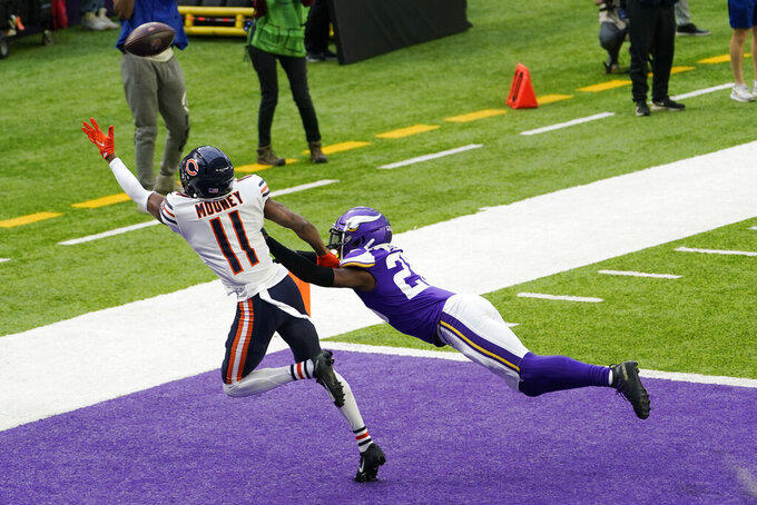 Minnesota Vikings cornerback Chris Jones breaks up a pass intended for Chicago Bears wide receiver Darnell Mooney (11) during the first half of an NFL football game, Sunday, Dec. 20, 2020, in Minneapolis. (AP Photo/Jim Mone)