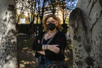 """Lucía Ruiz, who survived an attack by the Basque separatist militant group ETA in 1987 when she was 10 years old, poses for a photo near the site of the blast that targeted the military police barracks where she lived with her father, a civil guard, in Zaragoza, Spain, Friday, Oct. 16, 2020. Josu Urrutikoetxea, the last known chief of ETA, the now-extinct Basque separatist militant group, goes on trial Monday Oct. 19, 2020 in Paris for terrorism charges that he deems """"absurd"""" because of his role in ending a conflict that claimed hundreds of lives and terrorized Spain for half a century. (AP Photo/Renata Brito)"""