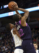Minnesota Timberwolves' Andrew Wiggins, right, shoots as Dallas Mavericks' Harrison Barnes defends against him in the first half of an NBA basketball game Friday, Jan. 11, 2019, in Minneapolis. (AP Photo/Jim Mone)