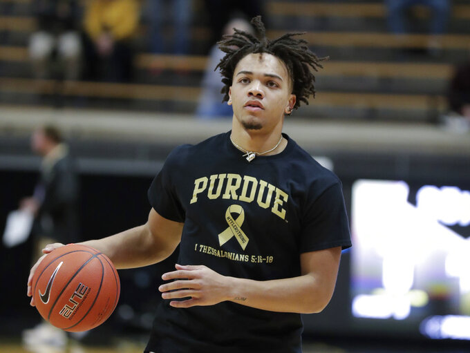 Purdue guard Carsen Edwards (3) wears a shirt honoring Tyler Trent before an NCAA college basketball game against Iowa in West Lafayette, Ind., Thursday, Jan. 3, 2019. Both Purdue and Iowa will pay their respects to late Boilermakers fan Tyler Trent on by wearing #TylerStrong T-shirts in his honor. Trent, a superfan who inspired people across the globe during his hard-fought battle with cancer, died this week. He was 20. (AP Photo/Michael Conroy)