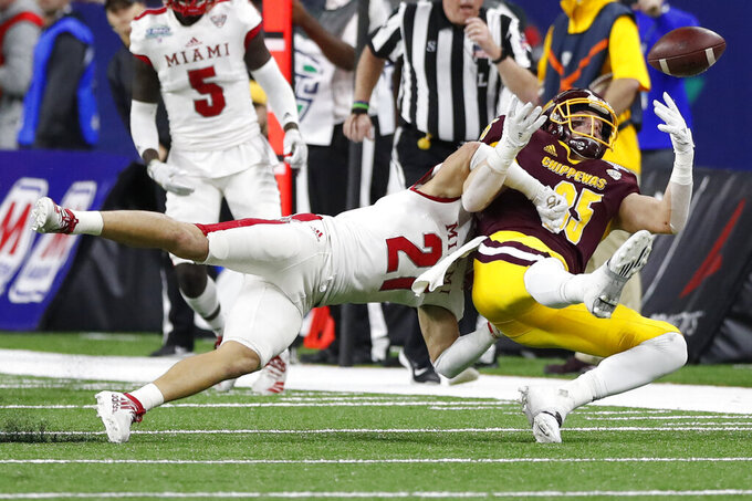 Miami of Ohio defensive back Sterling Weatherford (21) breaks up a pass intended for Central Michigan tight end Tony Poljan (85) during the first half of the Mid-American Conference championship NCAA college football game, Saturday, Dec. 7, 2019, in Detroit. (AP Photo/Carlos Osorio)