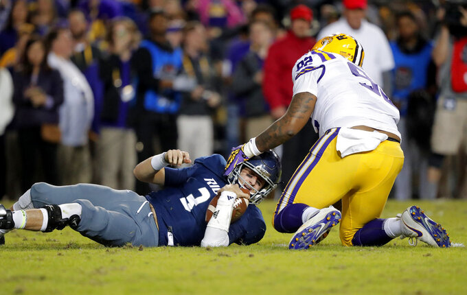 Rice quarterback Shawn Stankavage (3) looks up after being sacked by LSU defensive end Neil Farrell Jr. (92) in the first half of an NCAA college football game in Baton Rouge, La., Saturday, Nov. 17, 2018. (AP Photo/Gerald Herbert)