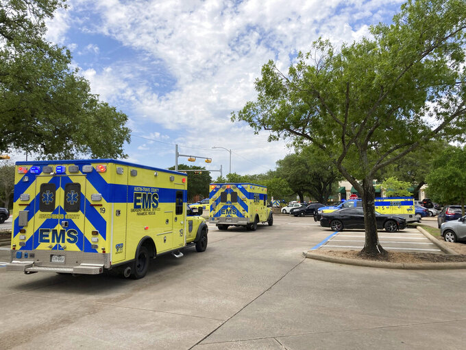 Emergency personnel work at the scene of a fatal shooting, Sunday, April 18, 2021, in Austin, Texas. Several people were fatally shot in Austin on Sunday and no suspects are in custody, emergency responders said. Police said on Twitter that they were on the scene of an active shooting and asked nearby residents to shelter in place and avoid the area. (AP Photo/Jim Vertuno)