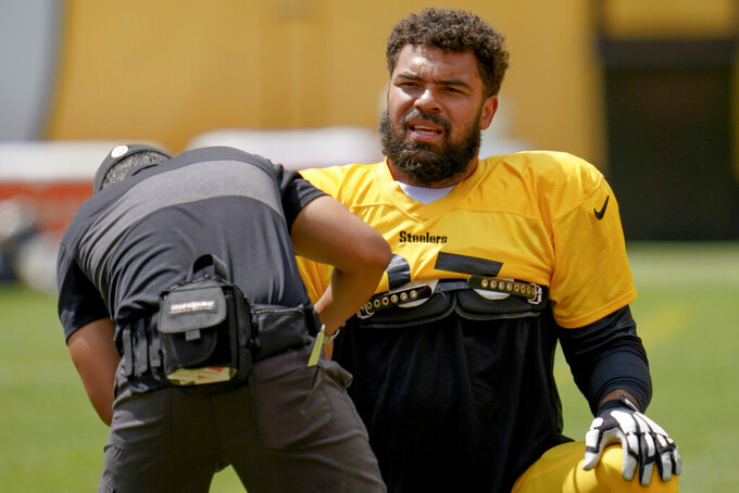 Pittsburgh Steelers defensive tackle Cameron Heyward (97) has his equipment adjusted during an NFL football training camp practice, Monday, Aug. 24, 2020, in Pittsburgh. (AP Photo/Keith Srakocic)