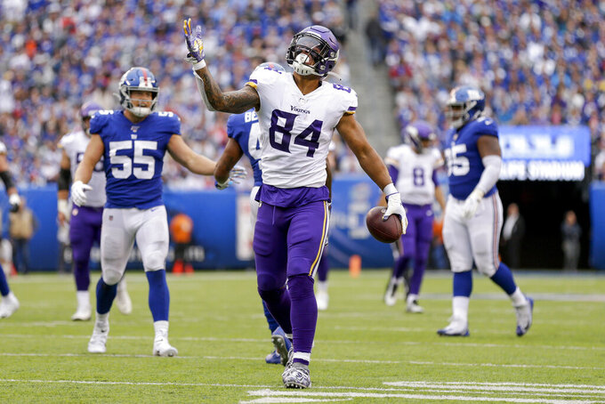Minnesota Vikings tight end Irv Smith (84) celebrates after making a catch against the New York Giants during the second quarter of an NFL football game, Sunday, Oct. 6, 2019, in East Rutherford, N.J. (AP Photo/Adam Hunger)