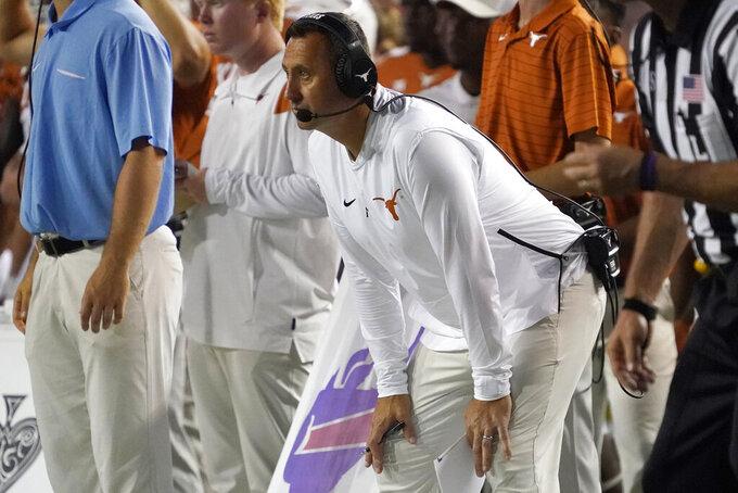 Texas coach Steve Sarkisian watches the team play against Rice during the second half of an NCAA college football game Saturday, Sept. 18, 2021, in Austin, Texas. (AP Photo/Chuck Burton)
