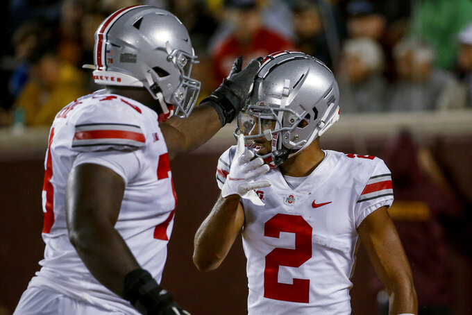Ohio State wide receiver Chris Olave (2) celebrates his touchdown catch against Minnesota with tackle Nicholas Petit-Frere (78) during the third quarter of an NCAA college football game Thursday, Sept. 2, 2021, in Minneapolis. Ohio State won 45-31. (AP Photo/Bruce Kluckhohn)