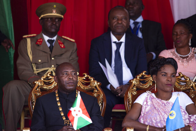 Burundi's President Evariste Ndayishimiye, left, and his wife Angeline Ndayubaha, right, attend his inauguration in Gitega, Burundi, Thursday, June 18, 2020. President Evariste Ndayishimiye took power two months early after the abrupt death of his predecessor Pierre Nkurunziza. (AP Photo/Berthier Mugiraneza)