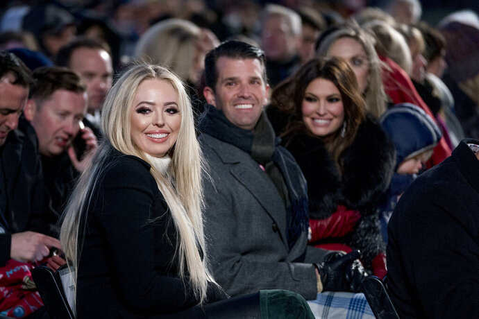 "FILE - In this Nov. 28, 2018, file photo from left, Tiffany Trump, the daughter of President Donald Trump, Donald Trump Jr. and Kimberly Guilfoyle, arrive ahead of President Donald Trump and first lady Melania Trump at the National Christmas Tree lighting ceremony at the Ellipse near the White House in Washington. Tiffany, recently graduated from Georgetown Law School. ""Just what I need is a lawyer in the family. Proud of you Tiff!"" President Donald Trump said Wednesday, May 20, 2020, in a congratulatory tweet. (AP Photo/Andrew Harnik, File)"