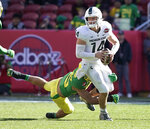 Michigan State quarterback Brian Lewerke (14) is sacked by Oregon safety Brady Breeze (25) during the first half of the Redbox Bowl NCAA college football game Monday, Dec. 31, 2018, in Santa Clara, Calif. (AP Photo/Tony Avelar)