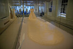 """The wedding dress of Britain's Princess Diana is displayed during a media preview for the """"Royal Style in the Making"""" exhibition at Kensington Palace in London, Wednesday, June 2, 2021. The exhibition, which opens to visitors on Thursday and runs until January 2, 2022, explores the intimate relationship between fashion designer and royal client. (AP Photo/Matt Dunham)"""