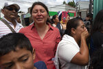 Family members wait outside the Air Force Base for the arrival of their relatives, who were deported from the United States, in Guatemala City, Tuesday, July 16, 2019. Nearly 200 Guatemalan migrants have been deported on Tuesday, the day the Trump administration planned to launch a drastic policy change designed to end asylum protections for most migrants who travel through another country to reach the United States. (AP Photo/Moises Castillo)