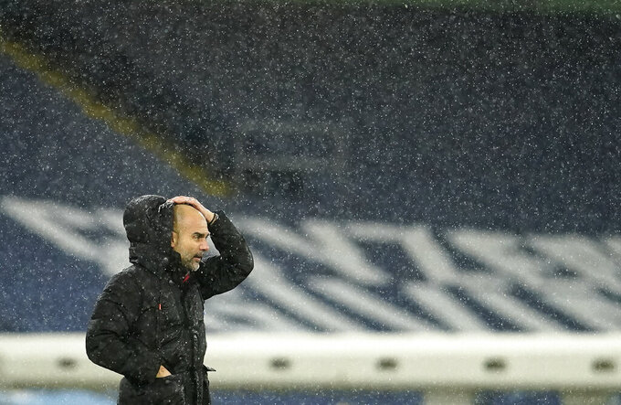 Manchester City's head coach Pep Guardiola stands on the touchline during the English Premier League soccer match between Manchester City and Newcastle United at the Etihad stadium in Manchester, Saturday, Dec. 26, 2020. (AP Photo/Dave Thompson, Pool)