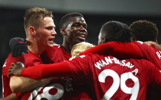 Manchester United's Paul Pogba, centre, celebrates with teammates their 2-1 lead during the English Premier League soccer match between Newcastle United and Manchester United at St. James' Park in Newcastle, England, Saturday, Oct. 17, 2020. (Alex Pantling/Pool via AP)
