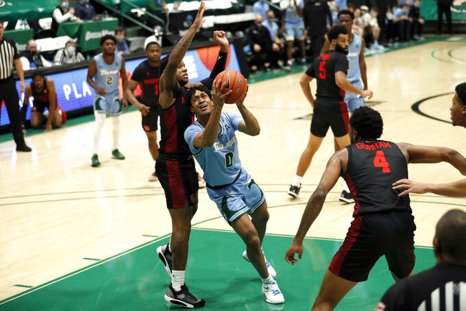 Tulane guard Gabe Watson, center, drives past Houston guard Marcus Sasser, front left, in the first half of an NCAA college basketball game in New Orleans, Thursday, Jan. 28, 2021. (AP Photo/Tyler Kaufman)