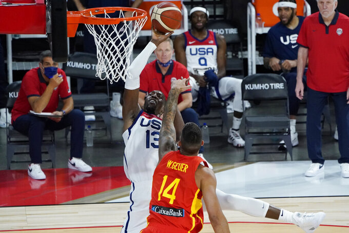 United States' Bam Adebayo (13) shoots against Spain's Willy Hernangomez (14) during the first half of an exhibition basketball game in preparation for the Olympics, Sunday, July 18, 2021, in Las Vegas. (AP Photo/John Locher)