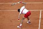 FILE - In this June 1, 2018, file photo, Serbia's Novak Djokovic smashes his racket during his third round match against Spain's Roberto Bautista Agut at the French Open tennis tournament in Paris, France. (AP Photo/Alessandra Tarantino, File)