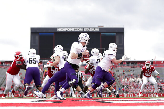 Northwestern quarterback Clayton Thorson (18) looks to pass against Rutgers during the first half of an NCAA college football game, Saturday, Oct. 20, 2018, in Piscataway, N.J. Northwestern won 18-15. (AP Photo/Julio Cortez)