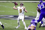 New Orleans Saints quarterback Drew Brees (9) passes in the first half of an NFL football game against the Minnesota Vikings in New Orleans, Friday, Dec. 25, 2020. (AP Photo/Butch Dill)