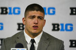 Purdue defensive end George Karlaftis talks to reporters during an NCAA college football news conference at the Big Ten Conference media days, at Lucas Oil Stadium in Indianapolis, Friday, July 23, 2021. (AP Photo/Michael Conroy)