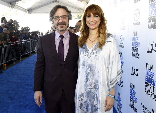 FILE - In this Feb. 8, 2020 file photo, Marc Maron, left, and Lynn Shelton arrive at the 35th Film Independent Spirit Awards in Santa Monica, Calif. Maron has mourned the sudden death of Shelton, his partner and frequent collaborator, in a new episode of his podcast Monday. Shelton died early Saturday morning at age 54 after a brief illness. (Photo by Richard Shotwell/Invision/AP, File)