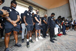 Denver Broncos players take part in a rally in the Greek Amphitheatre in Civic Center Park over the death of George Floyd Saturday, June 6, 2020, in downtown Denver. (AP Photo/David Zalubowski)