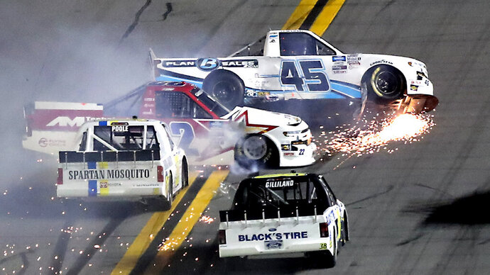Ty Majeski (45), Austin Wayne Self (22), Brennan Poole, front left, and Todd Gilliland, front right, wreck early in the NASCAR Truck Series auto race at Daytona International Speedway, Friday, Feb. 14, 2020, in Daytona Beach, Fla. (AP Photo/David Graham)