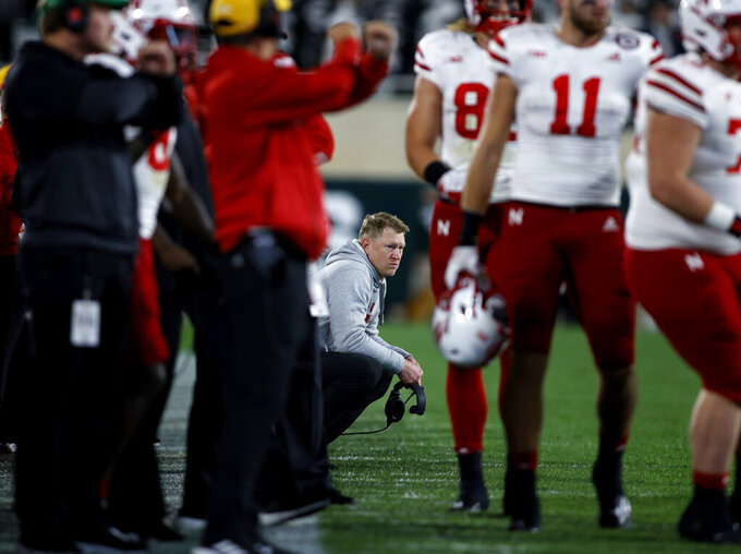 Nebraska coach Scott Frost, center, watches from the sideline against Michigan State during overtime of an NCAA college football game, Saturday, Sept. 25, 2021, in East Lansing, Mich. (AP Photo/Al Goldis)