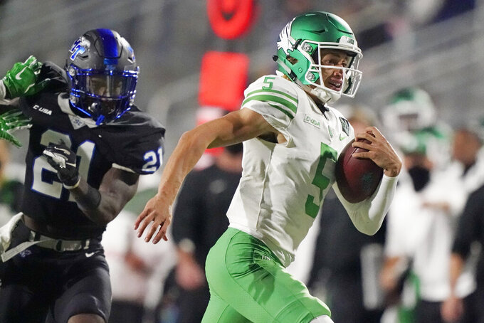 North Texas quarterback Jason Bean (5) scrambles past Middle Tennessee cornerback Kenneth Major (21) in the second half of an NCAA college football game Saturday, Oct. 17, 2020, in Murfreesboro, Tenn. (AP Photo/Mark Humphrey)
